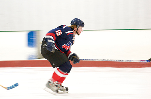 Max Wade picks up speed during a USA Warriors practice at the Kettler Capitals Iceplex in Arlington, Va.